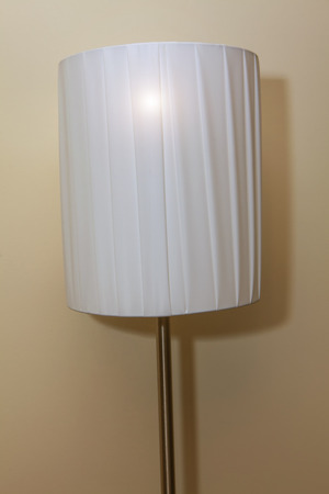 white floor lamp in bedroom