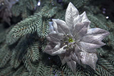 silver decorative flower on the Christmas tree