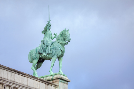 Statue of knight on horses on Sacre Coeur cathedral in Paris