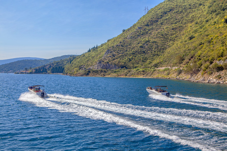 speeding on fast motor boats with splashing