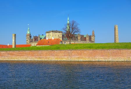 Kronborg castle and water canal in Helsingor , Denmark