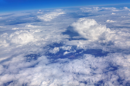 blue sky with clouds outer view from the airplane Reklamní fotografie
