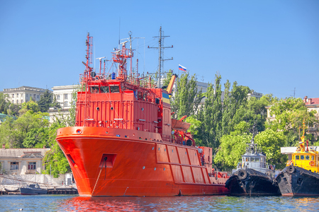 military ship colored in red Stock Photo - 124902587