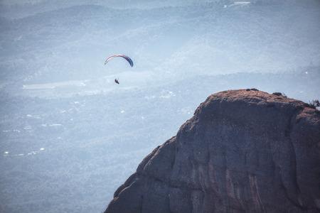 parachute flight over mountain peak