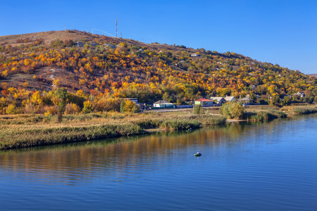 natural hill and river in the autumn