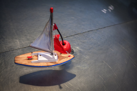 miniature toy ship in the water