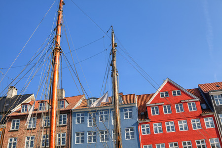 houses with colorful facades and old ships moored at Nyhavn in Copenhagen Stock Photo