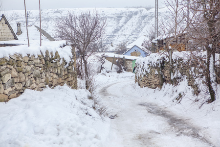 winter in village with traditional stone fence