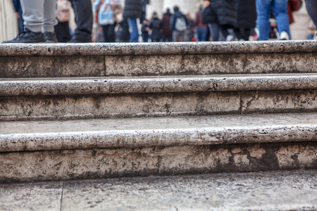 stone stairs details ,people feet view on the street