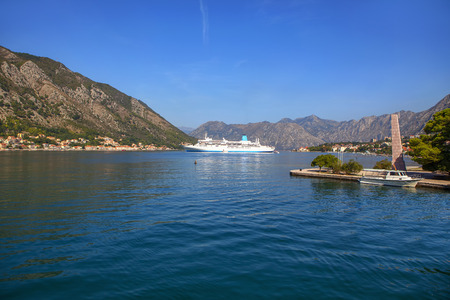 large cruise liner in the bay , landscape with mountains and Kotor Bay