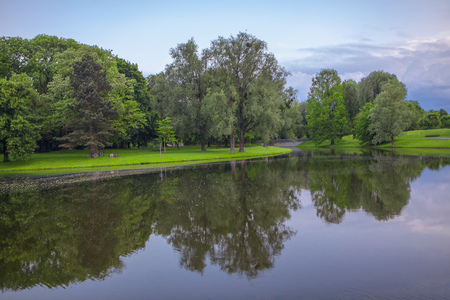 calm weather, green park in the summer and lake Reklamní fotografie
