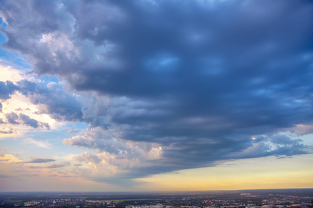city panorama with dramatic clouds on the sky