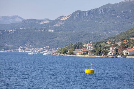 yellow buoy in the blue sea