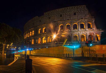 Via Dei Fori Imperiali and Colosseum in the night