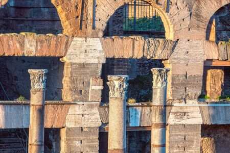 ancient columns and ruined architecture in Rome , Italy