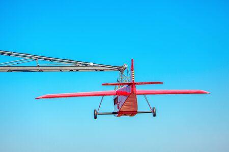 plane in the amusement park against blue sky