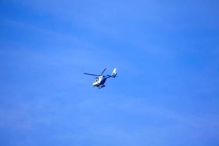 helicopter flying on blue sky 스톡 콘텐츠