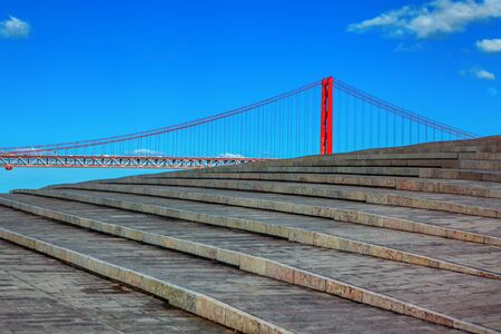 view of stone stairs and famous bridge in Lisbon 写真素材