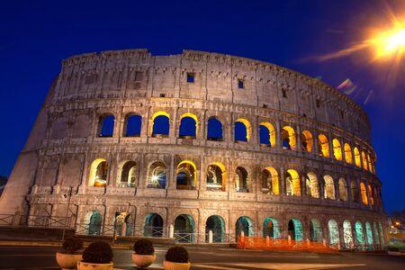 Colosseum illuminated at night , Rome Italy