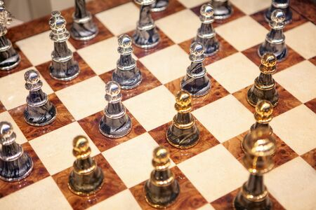 playing with golden and silver chess