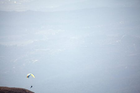 natural atmospheric background with paragliding flight