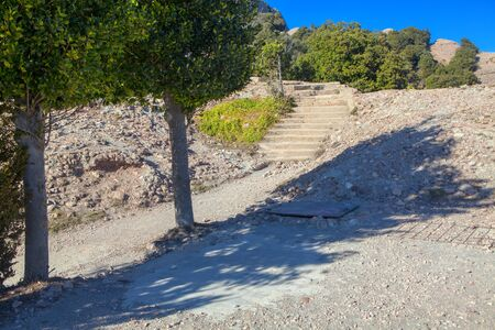 walking path with stone stairs in the mountains