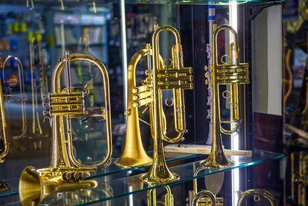 golden trumpets on the showcase Фото со стока