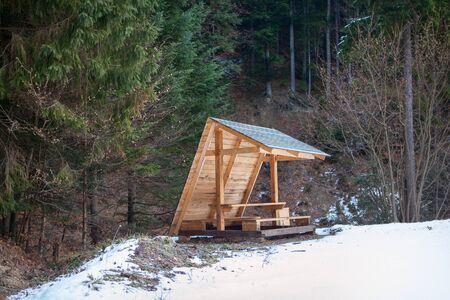 wooden gazebo in the snowy forest Stok Fotoğraf