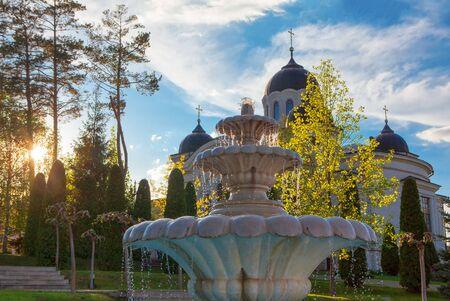 fountain and church in sunlight