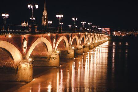 Pont de Pierre in the night , Bordeaux France