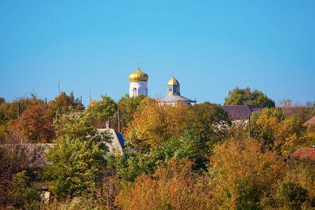 autumn image with church in the village Zdjęcie Seryjne
