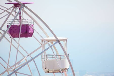 ferris wheel with empty cabins Stock Photo