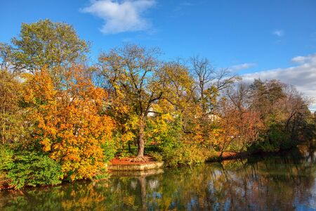 Amazing autumn scenery with calm lake and colorful trees