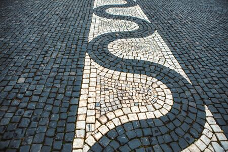 pavement made by black and white stones Stock Photo
