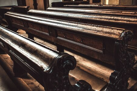 old wooden benches inside the church