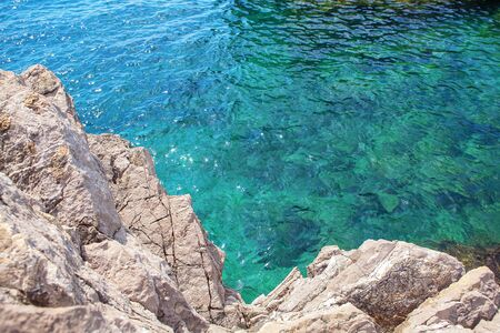 cliff and blue transparent water 스톡 콘텐츠