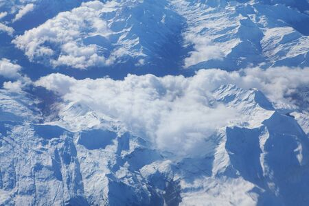 image of clouds and snowy mountains