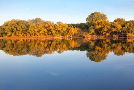 autumnal scenery with lake and colorful trees