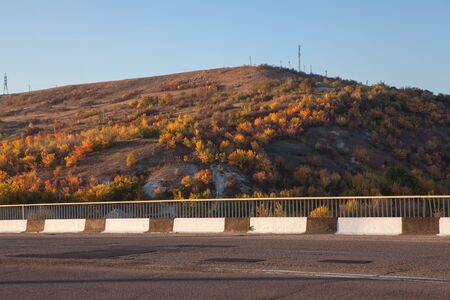 side part of road and hill in the autumn