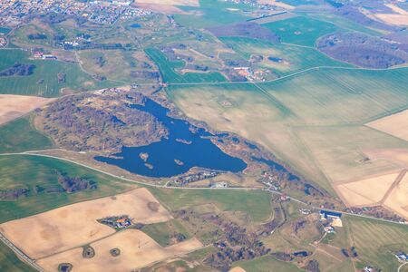 flying over the agricultural fields and lake 스톡 콘텐츠