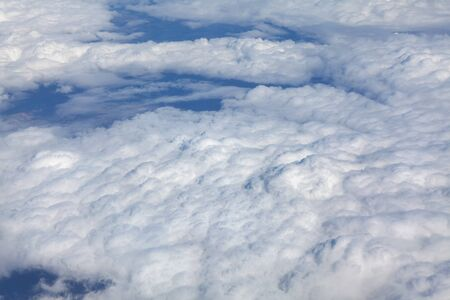 flying through  snowy white clouds