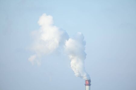 toxic industrial smoke rising in the sky