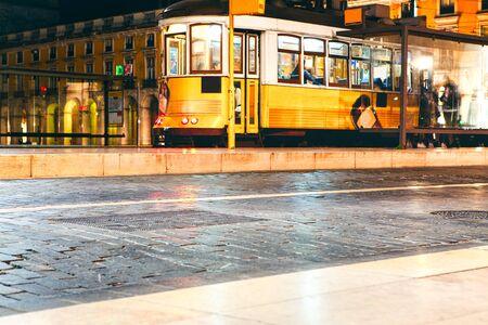 Famous yellow tram on the night street of Lisbon