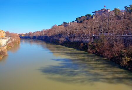 view of flowing Tiber river in Rome
