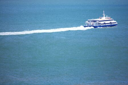 modern passenger boat speeding on the sea