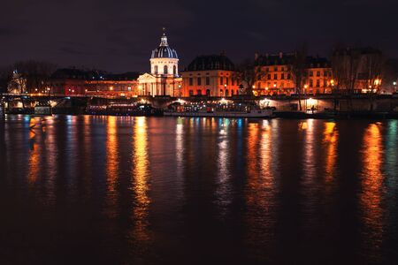 Night view of Les Invalides and Seine River in Paris