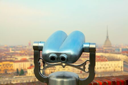Looking at Turin city through tourist binoculars
