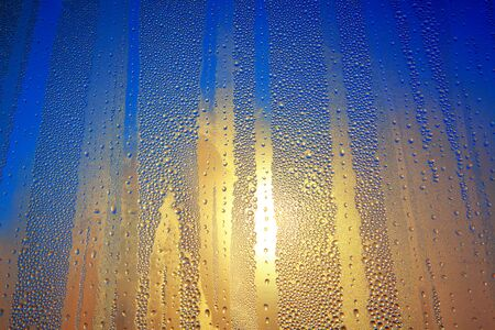 condensation on glass with sunlight