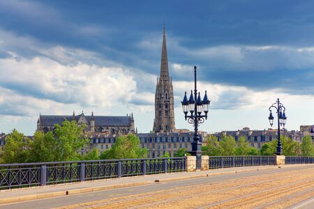 Basilica of Saint Michael and Pont de Pierre in Bordeaux Stock Photo