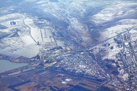 late autumn aerial view , first snow on the fields